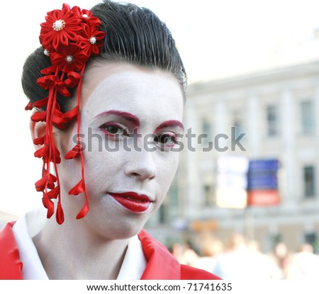 close up portrait of beauty japan geisha in red kimono smiling - stock photo