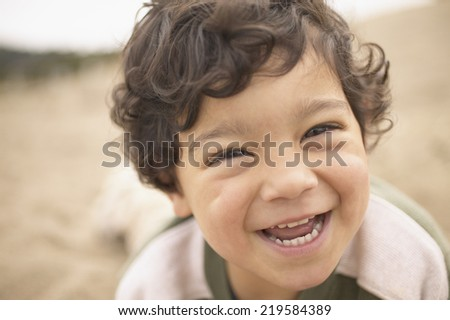 Close up portrait of boy laughing - stock photo