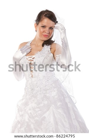 close-up portrait of bride dressed in elegance white wedding dress, isolated on white - stock photo