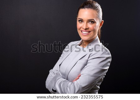 close up portrait of business woman isolated on black background - stock photo
