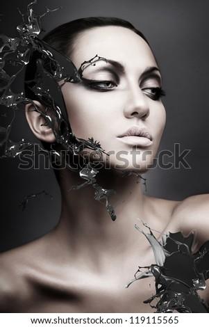 close up portrait of calm brunette woman black splash - stock photo