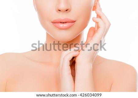 Close up portrait of calm young woman holding hands near face - stock photo