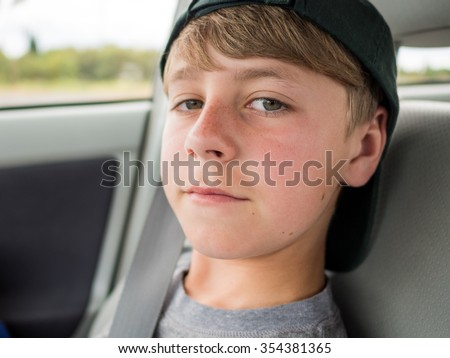 Close up portrait of casual teenage boy with backwards hat - stock photo