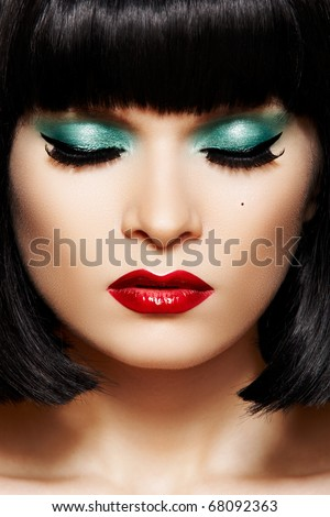 Close-up portrait of caucasian young woman with retro glamour make-up. Bob hairstyle, christmas makeup