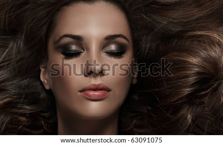 close up portrait of charming brunette - stock photo
