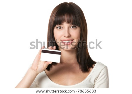 Close-up portrait of cheerful female holding credit card isolated on white background - stock photo
