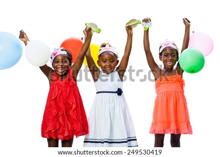 Close up portrait of cheerful threesome African youngsters holding colorful balloons.Isolated against white background. - stock photo