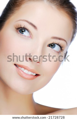 Close-up portrait of cheerful young adult girl - looking up - stock photo