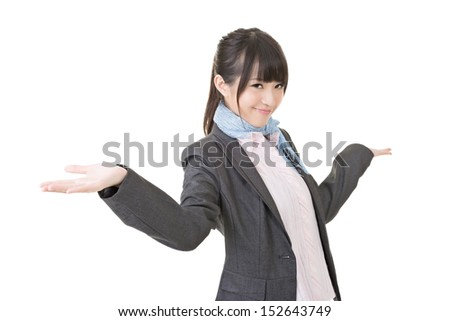 Close-up portrait of cheerful young asian business woman shrugging. Isolated on the white background.