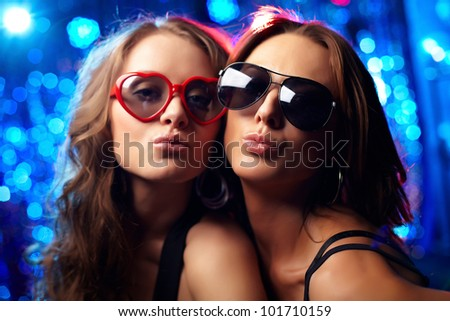 Close-up portrait of cool girls at nightclub - stock photo