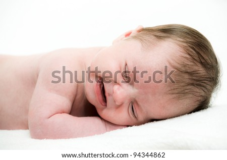 close up portrait of crying baby - stock photo