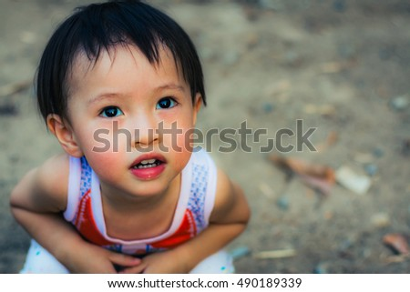 Close up portrait of cute baby in vintage image.Eyes of a child.