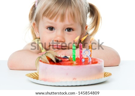 Close up portrait of cute girl with birthday cake.Isolated on white.