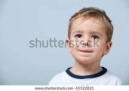 Close up portrait of cute little boy on background - stock photo
