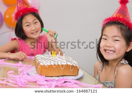 Close-up portrait of cute little girls at birthday party - stock photo