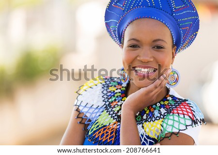 close up portrait of cute south african woman outdoors - stock photo
