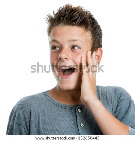 Close up portrait of cute teen boy looking aside with hand on face.Isolated on white background. - stock photo