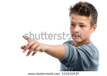 Close up portrait of cute teen boy pointing with finger into the distance.isolated on white background. - stock photo