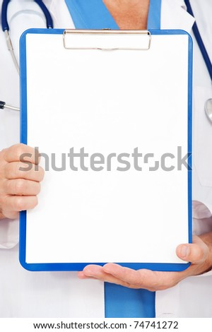 close-up portrait of doctor holding empty clipboard - stock photo