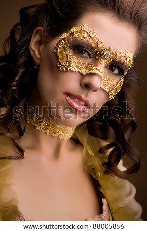 close up portrait of elegant girl with a mask painted on her face