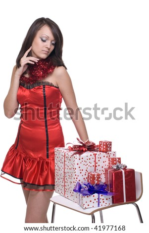 Close up portrait of emotional girl in santa claus dress, white fur and some gifts