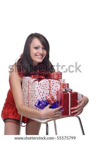 Close up portrait of emotional girl in santa claus dress, white fur and some gifts - stock photo