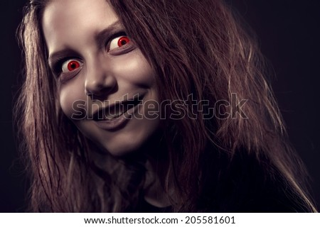 Close up portrait of evil girl possessed by a demon - stock photo
