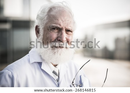 Close-up portrait of experienced researcher looking at the camera - stock photo