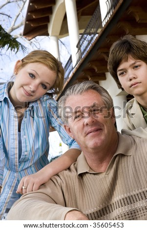 Close-up portrait of father with daughter and son - stock photo