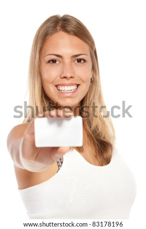 Close-up portrait of female holding credit card, shallow depth of field, focus on the female, over white background - stock photo