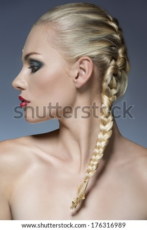 close-up portrait of female profile with creative strong make-up and bride blonde hair-style  - stock photo