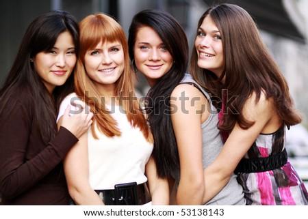 Close-up portrait of four urban women outside - stock photo