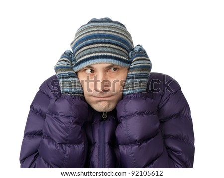 Close-up portrait of freezing young man - stock photo