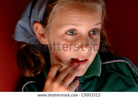 close-up portrait of girl looking amazed - stock photo