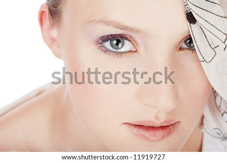 Close-up portrait of girl with beautiful turquoise blue eyes