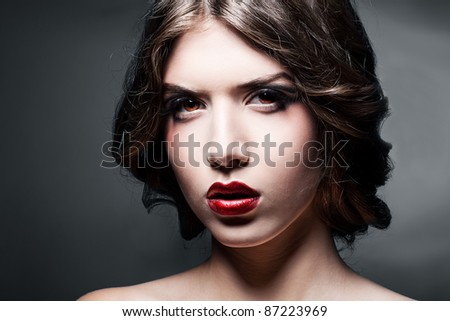 close-up portrait of girl with big red lips