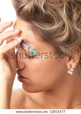 close-up portrait of girl with syringe isolated on white; shallow DOF, focus on closed eye ;
