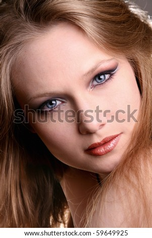 Close-up portrait of girl with vivid make-up