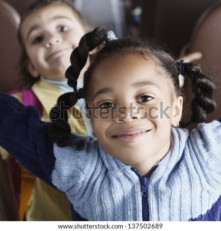 Close up portrait of girls on school bus