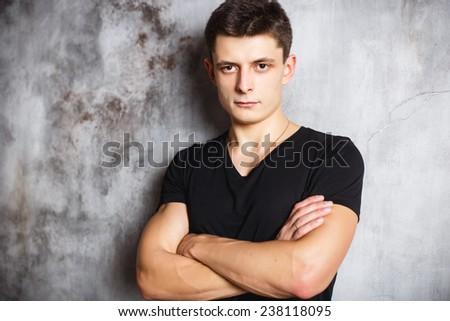 Close-up portrait of gorgeous young man in black t-shirt - stock photo