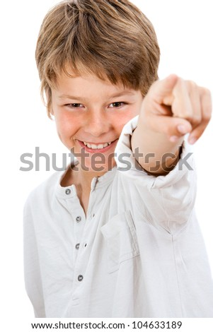 Close up Portrait of handsome boy pointing at you.Isolated on white. - stock photo