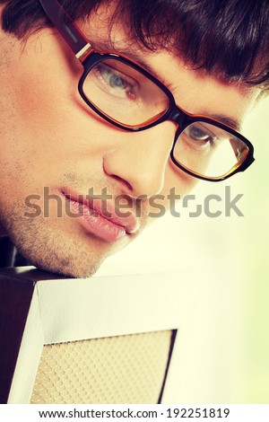 Close up portrait of handsome man in glasses - stock photo