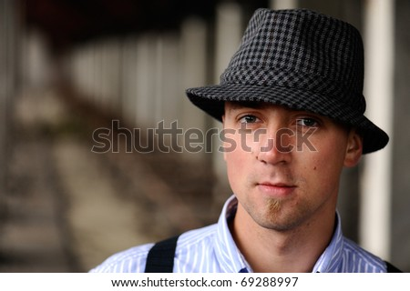 close up portrait of handsome man in grey checkered hat