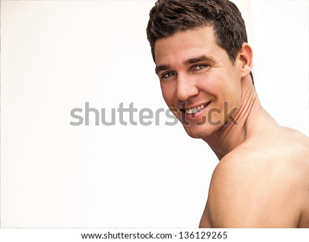 Close-up portrait of happy adult attractive man. Photo with copy-space. - stock photo
