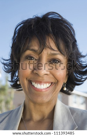 Close-up portrait of happy African American senior woman smiling outdoors - stock photo