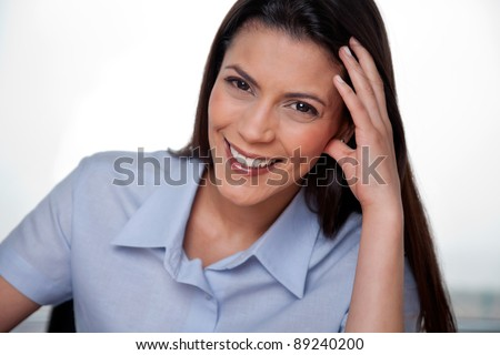 Close-up portrait of happy businesswoman smiling - stock photo