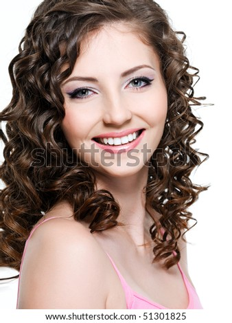Close-up portrait of happy cheerful young beautiful woman with curly hair