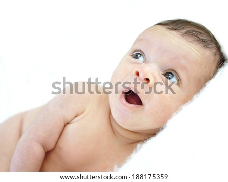 close up portrait of happy cute little newborn baby in sweet face expression with eyes big opened isolated on white - stock photo