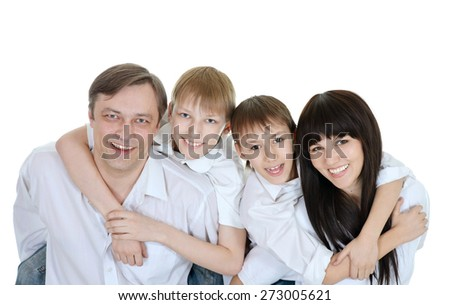 close-up portrait of happy family of four hugging on white background - stock photo