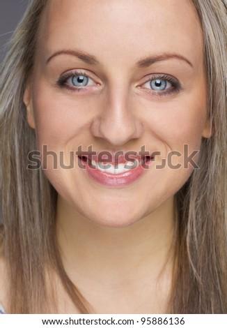 Close-up portrait of happy female - stock photo